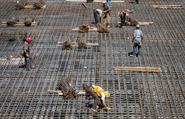 lay rebar for the base of a condo project along Bank Street on ...