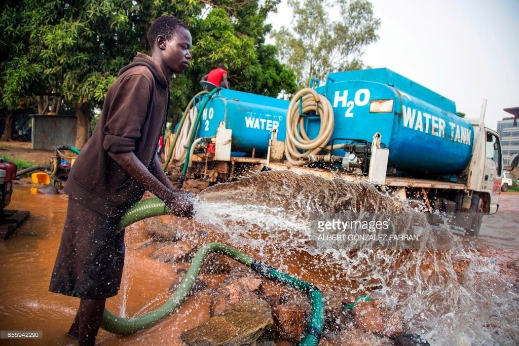 A truck driver collects water directly pumped from the Nile river ...