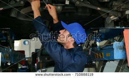 Male Mechanic Examining Car Using Flashlight Stock Photo 124822390 ...