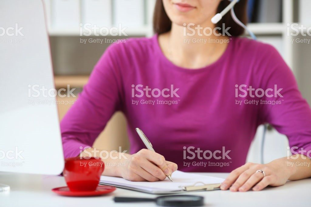 Woman Callcenter Specialist Takes Orders By Phone And Write It In ...