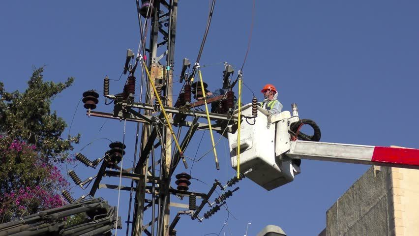 Electricians Of The Israeli Electric Co Fixing High Voltage ...