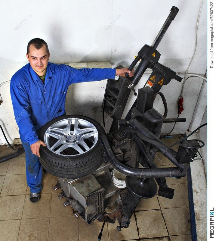 Tyre Changing Machine, Mechanic Fixing Tire In Car Service Stock ...