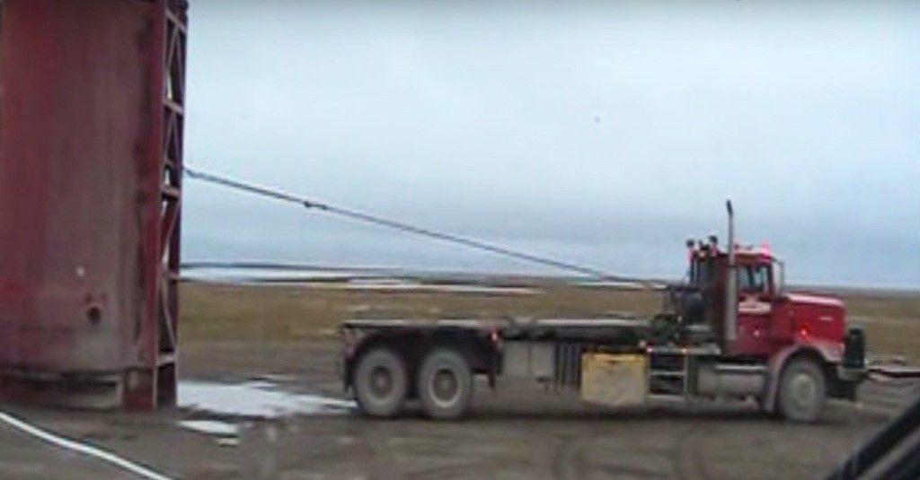 Truck Driver Loads Massive Water Tank in Alaskan Wilderness |