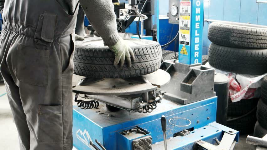 Mechanic Using Tire Mounting Tool Machine. Stock Footage Video ...