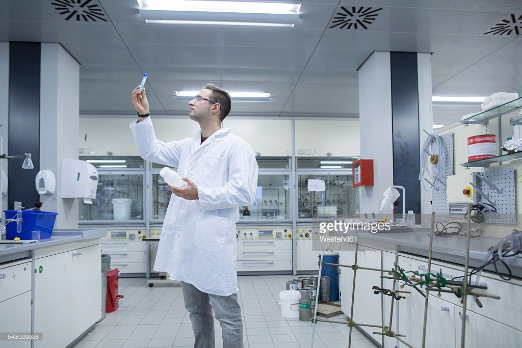 Chemist Working In Lab Looking At Test Tube Stock Photo | Getty Images