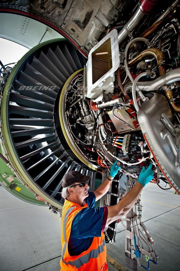 Boeing Images - Boeing Mechanic Inspects 777 Engine