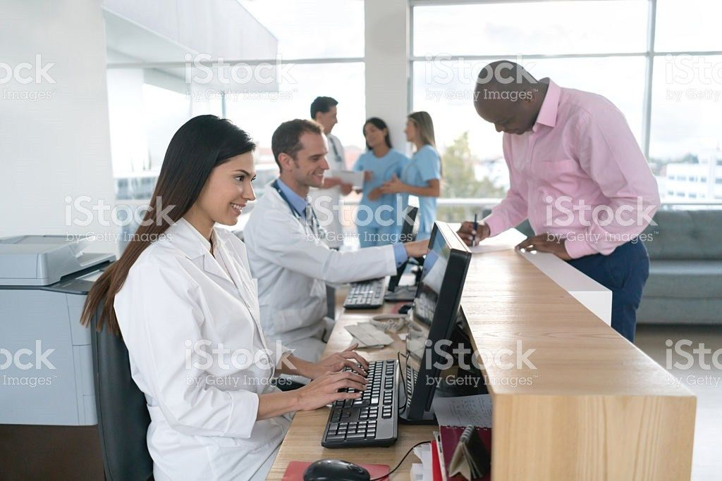 Medical Receptionist Uniforms Pictures, Images and Stock Photos ...