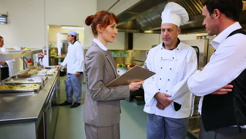 Restaurant Manager Chatting With Waiter And Head Chef In A ...