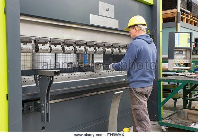 Metal Press Operator Stock Photos & Metal Press Operator Stock ...