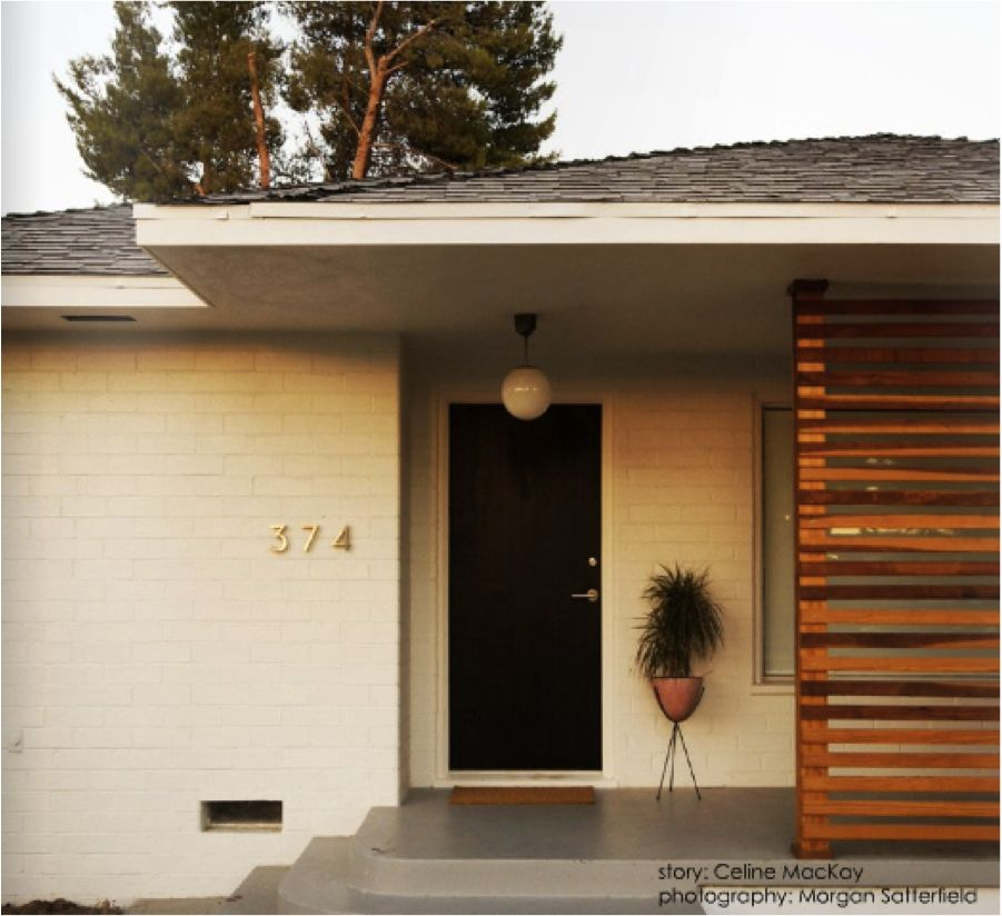 Ranch done right natural wood shutters charcoal painted for Modern exterior wall design