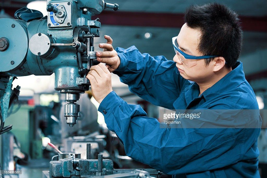 Factory Worker Using Drilling Machine Stock Photo | Getty Images