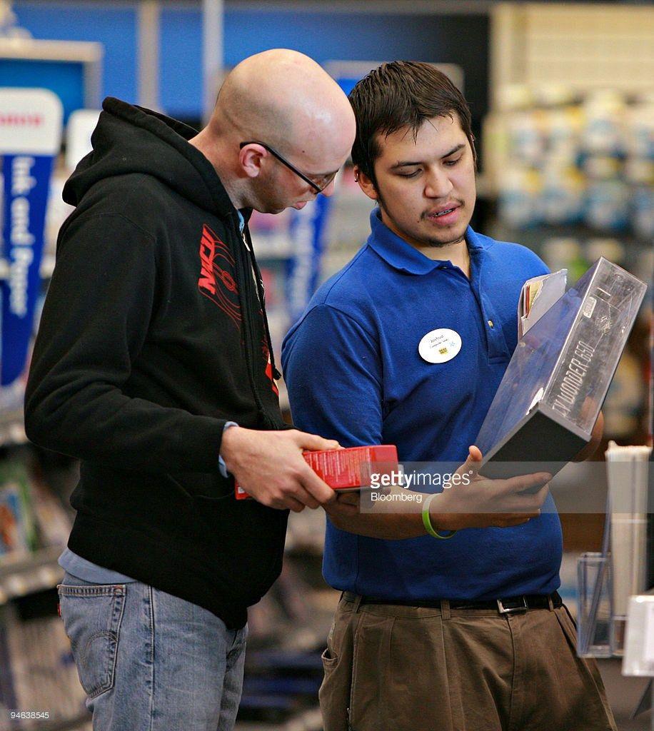 Best Buy Sales Associate Josh Flores, left, assists Chad Cox ...