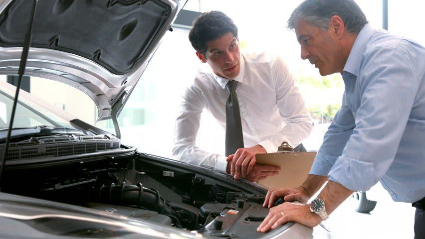Sales Manager Showing Customer Engine Of The New Car Stock Footage ...