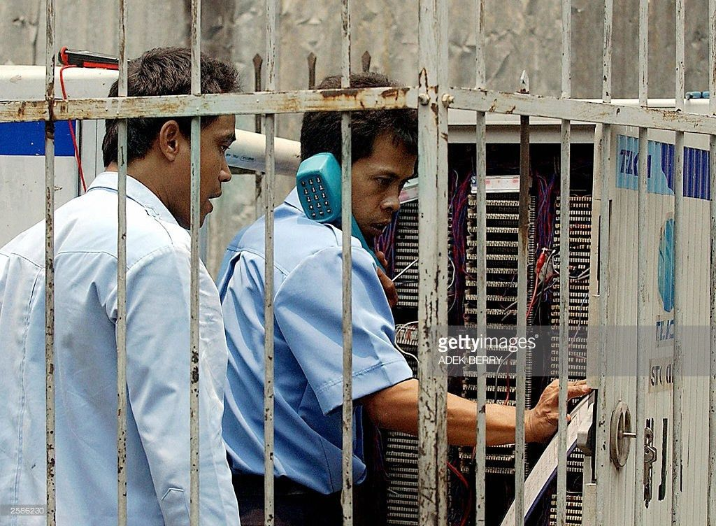 Two Indonesian technician of PT. Telecom Pictures | Getty Images
