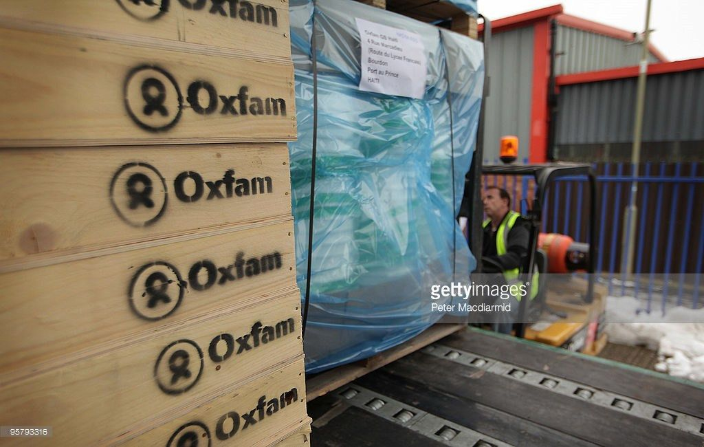 Aid Bound For Haiti Is Prepared At The Oxfam Warehouse Photos and ...