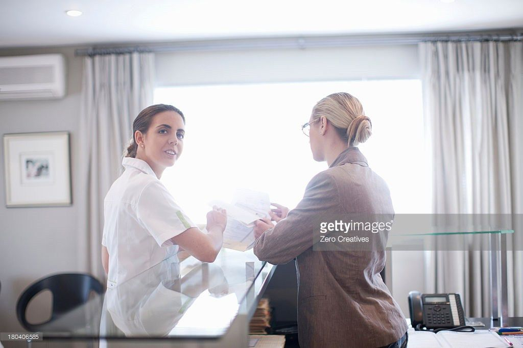 Receptionist Looking Through Hospital Index Cards Stock Photo ...