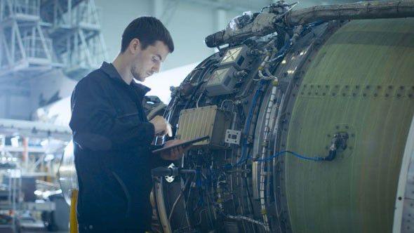 Aircraft Maintenance Mechanic Inspecting and Working on Airplane ...