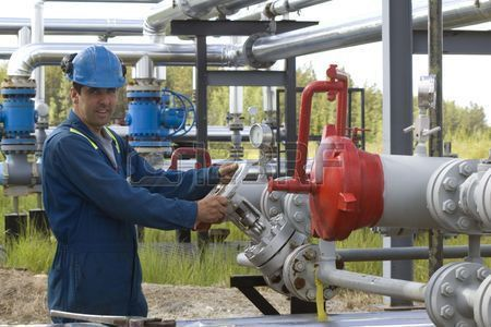 Gas Production Operator Maintains Well Site Stock Photo, Picture ...