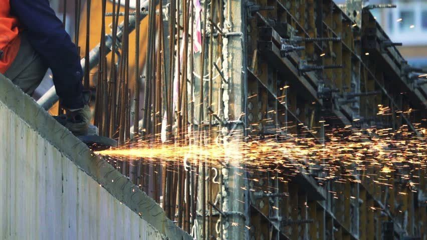 Industrial Worker Cuts Rebar With A Angle Grinder, Slow Motion ...