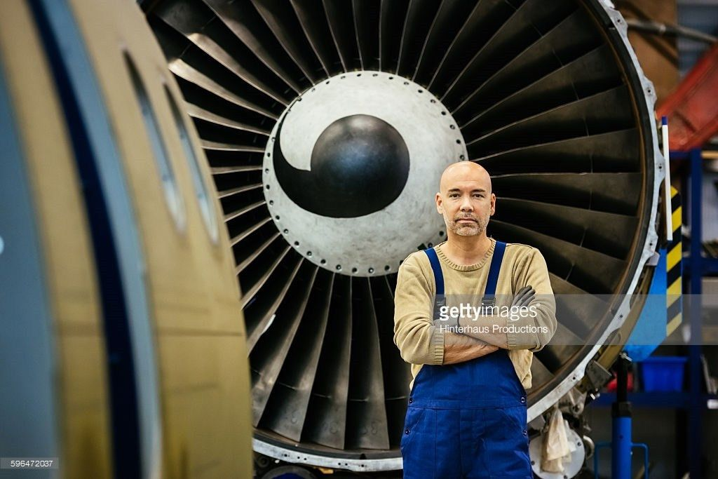 Aircraft Mechanic Lying Underneath A Jet Engine Stock Photo ...