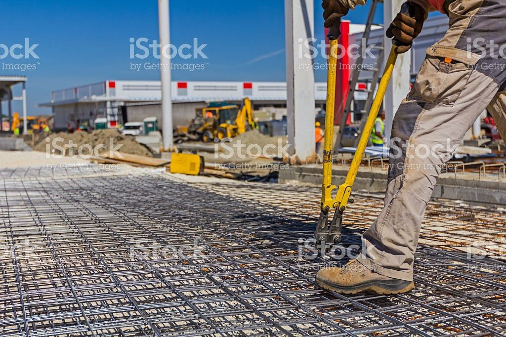 Worker Is Cutting Rebar With Scissors For Reinforcement Bars stock ...