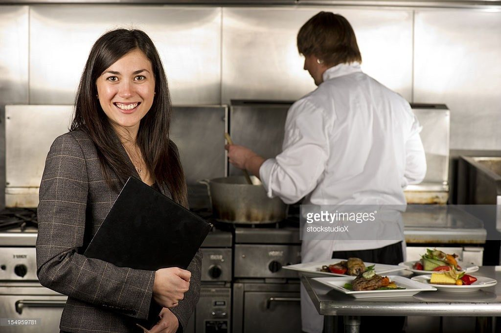 Restaurant Manager Giving Instructions To Team Of Chefs And ...