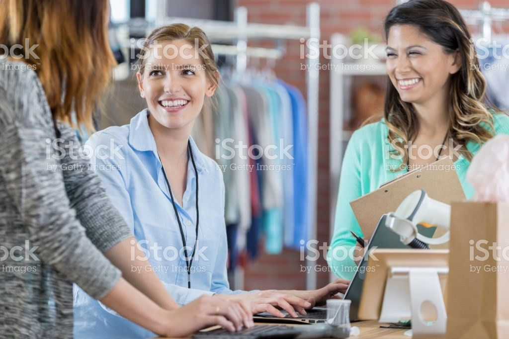 Salesperson Talking To Customers In Fashion Store Pictures, Images ...