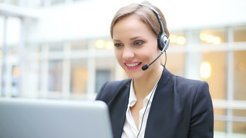 Female Customer Support Operator With Headset Talking And Smiling ...