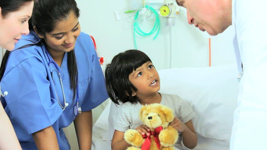 Young Female Pediatric Patient Receiving Treatment And Comfort ...