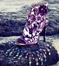 Oceana Swarovski crystal and resin collar necklace, House Of Lavande; Roberto Cavalli baroque printed bootie