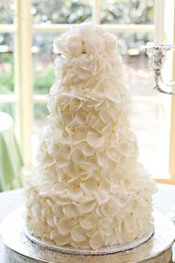 Snowy white, perfect petals adorn this wedding cake wonder.