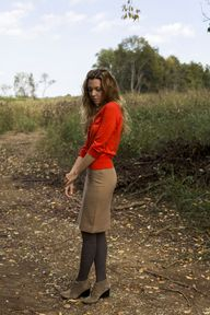 red top + tan skirt