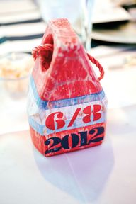 Nautical wedding buoy table numbers Photo: Captured Photography by Jenny