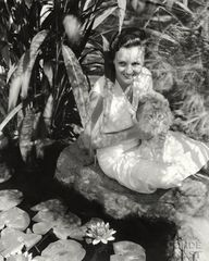 Mary Astor holding a