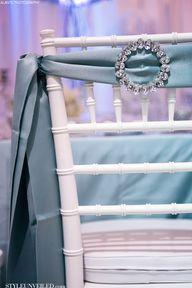 Jeweled blue sash on...
