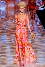 Badgley Mischka Spring 2012 collection. Ruffled maxi dress with bright orange and pink floral pattern.