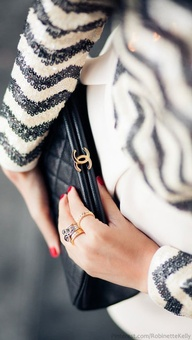 A Chanel clutch is j...