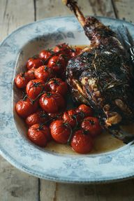 Slow Roast Lamb with Rosemary and Garlic, and Vine Tomatoes
