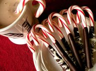 Dip candy canes in c...
