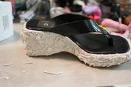 working on a shoe, p