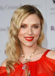 Scarlett Johansson is a good example of a red orange  lipstick on a warm or neutral skin tone