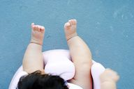 baby in pink bumbo