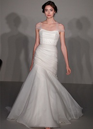 Strapless silk organza fit n flare bridal gown with sheer tulle strap detail. Lightly jeweled draped dropped waist torso with a flared organza skirt.