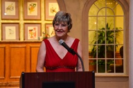 Sister Cities of Sarasota Director of Events Gayle Maxey take the podium to inform the SisterCities 50th Anniversary gala attendees about the citizen diplomacy   involvement of former Sarasota Mayor Lou Ann Palmer who she nominated for the 2013 One World Award.  Photo by Eric Hilton
