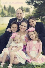 posing family of six