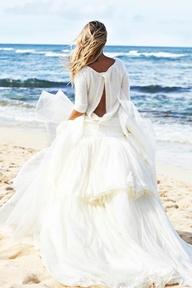 Beach bride in flowi