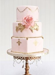 The La Vie en Rose cake by Mimi's Cakes and Bakes features a pale pink fondant with golden accents and a large pink rose with gilded leaves - glorious!