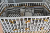 Gray and yellow crib