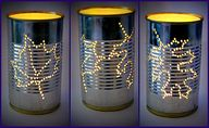 Using Ice in can to stabilize it for punching through it. #diy #crafts #leaves #tea_lights #candles #cans #lighting