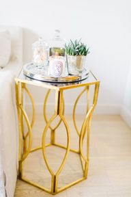 A gold side table is